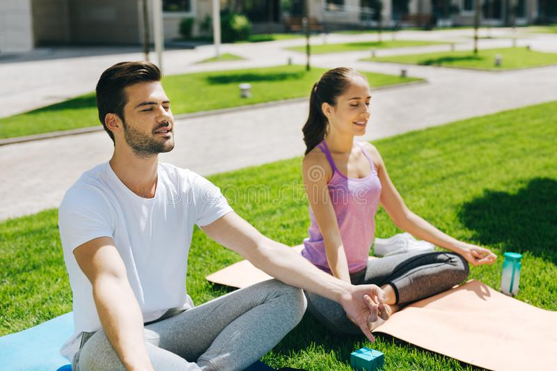 Positive joyful people practicing yoga royalty free stock image