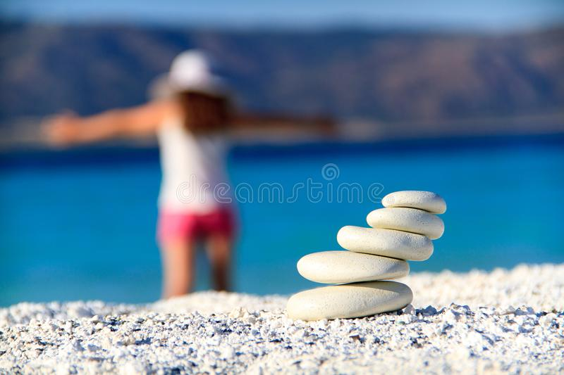 Body of a beautiful girl in a meditation on the beach.  royalty free stock image