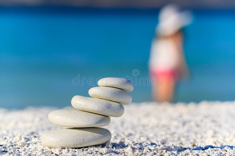 Body of a beautiful girl in a meditation on the beach.  royalty free stock photos