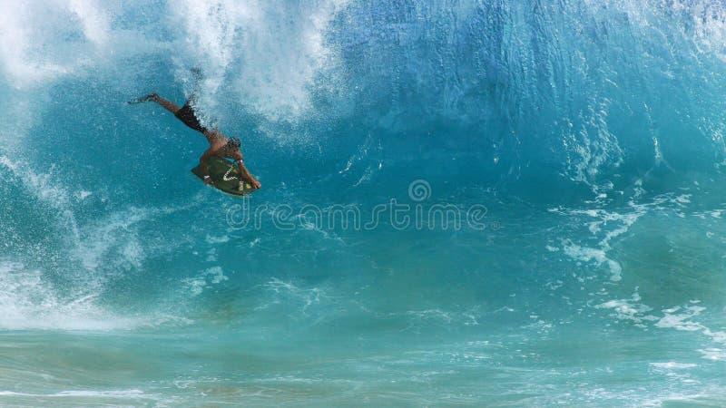 Body boarder, Sandy beach Hawaii royalty free stock image