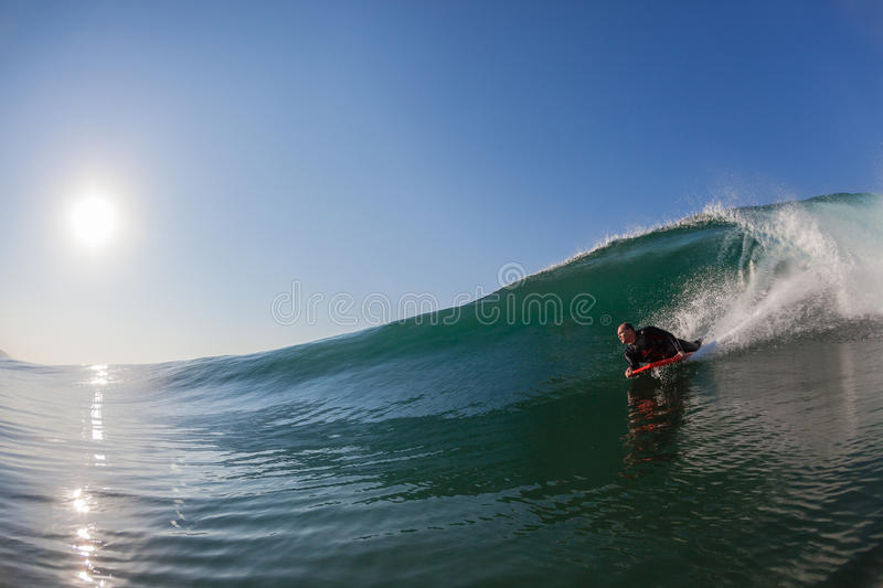 Body-Boarder Surfing Glass Wave stock photos