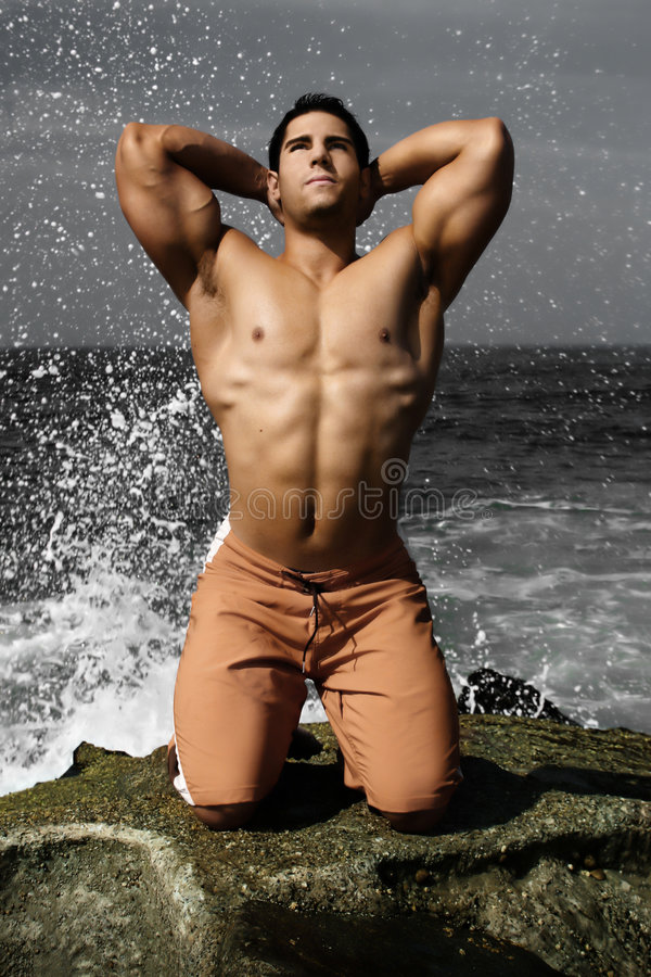 Body Builder on Beach stock photography