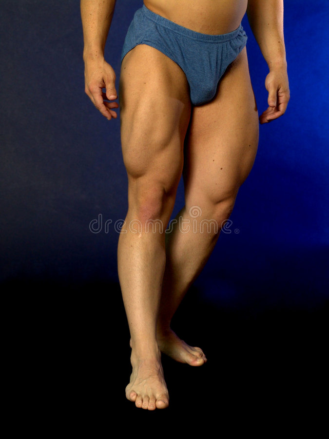 Body builder legs. Male body builders legs gradiated blue black background royalty free stock image