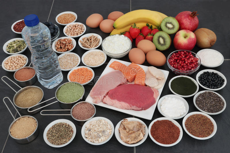 Body Building Health Food Collection. Body building food of high protein lean meat and salmon, supplement powders, fruit, nuts, seeds, grains, pulses, herbs royalty free stock image