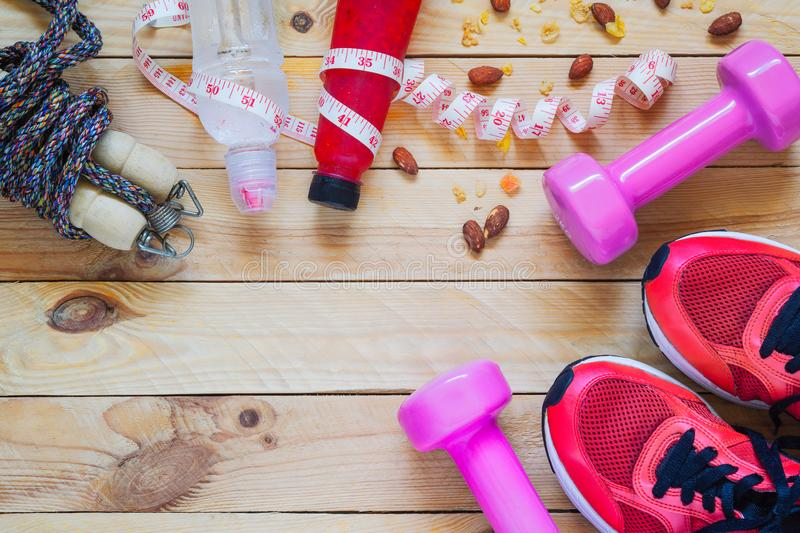 Body Care and Beauty, Weight and Dieting Healthy lifestyle concept. Sport equipment, Dumbbells, running shoes, skipping ropes on stock photos