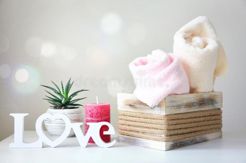 Body care items,bathroom towels,soap.Bathroom objects. Body care concept,bathroom items.Rolled towels.Natural hygienic staff empty copy space background stock photography