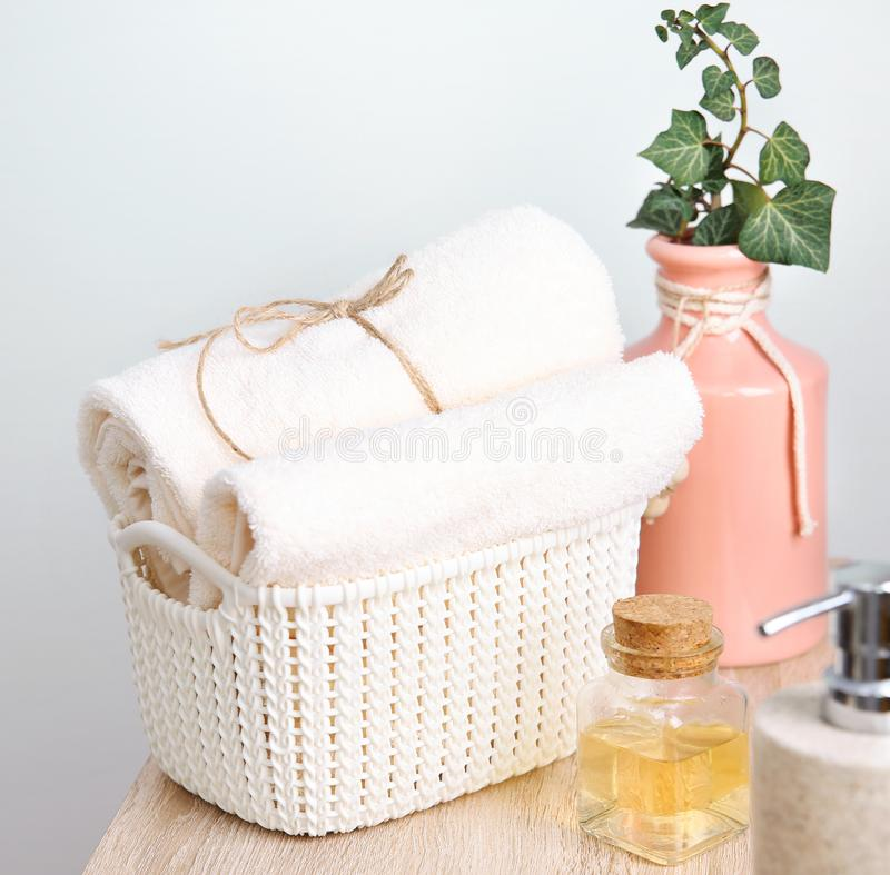 Body care items,bathroom towels,soap and oil. Body care concept. Hotel bathroom items.Stack folded rolled towels.Natural hygienic staff stock photo