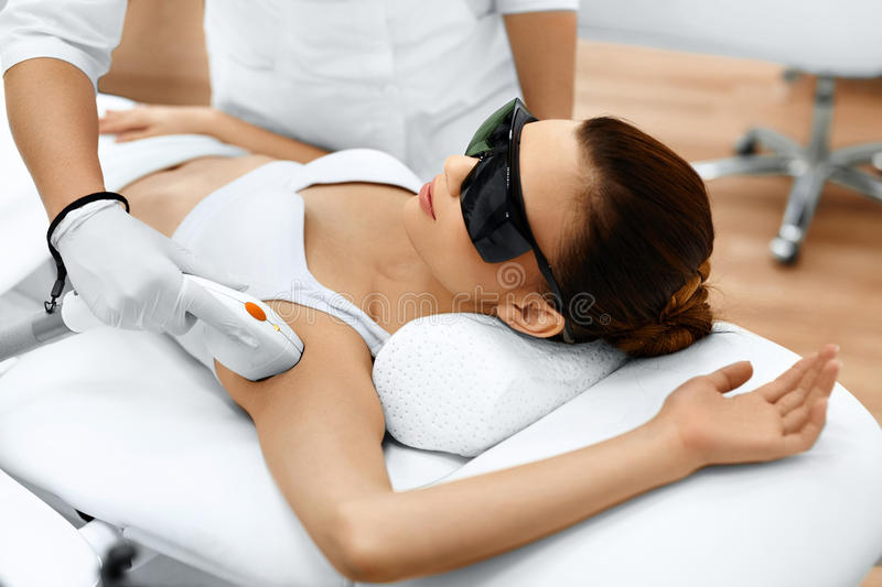 Body Care. Laser Hair Removal. Epilation Treatment. Smooth Skin. Body Care. Underarm Laser Hair Removal. Beautician Removing Hair Of Young Woman's Armpit. Laser stock images