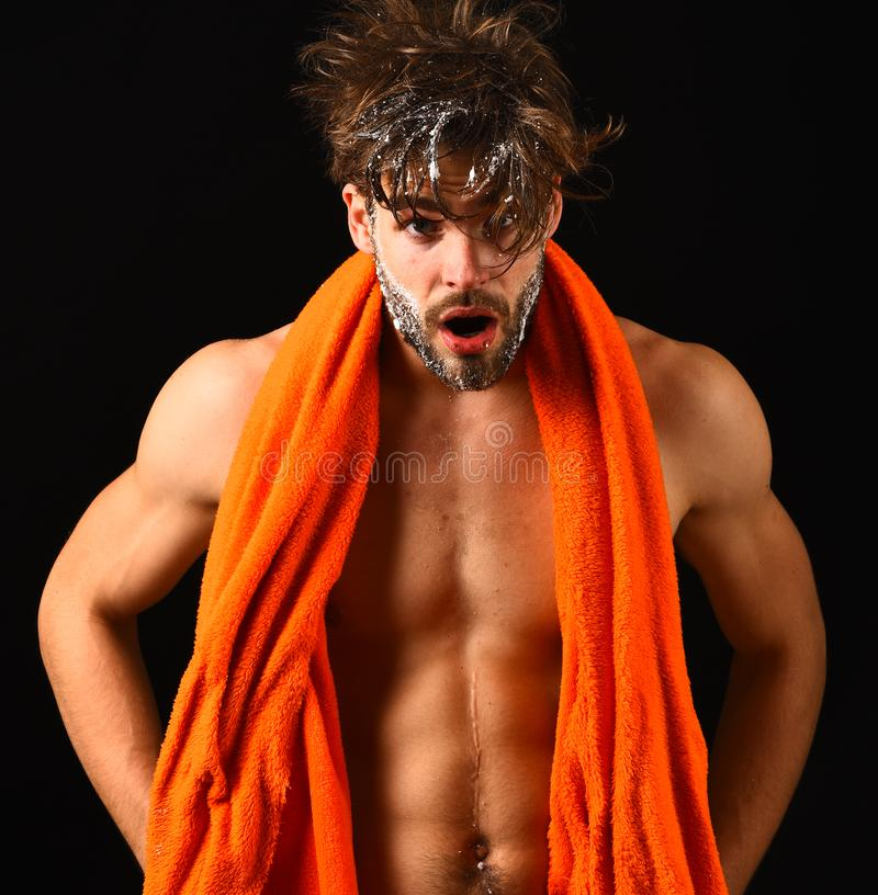 Body care. Macho attractive nude guy black background. Man bearded tousled hair covered with foam or soap suds. Wash off. Foam with water carefully. Man with stock photography