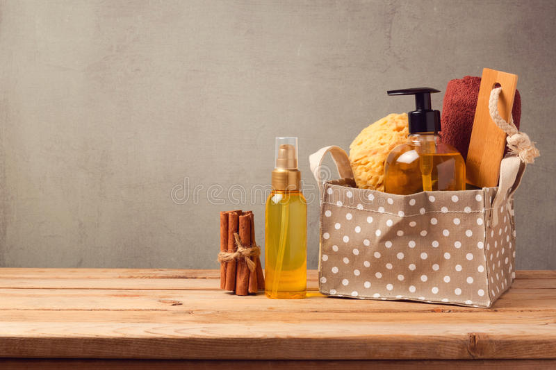 Body care and personal hygiene products on wooden table. Over gray background royalty free stock images