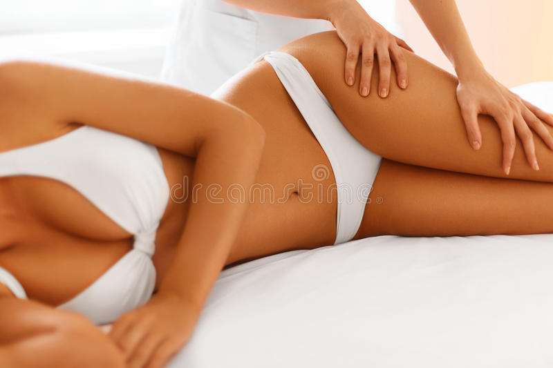 Body care. Spa body massage treatment. Body Care. Spa Massage Treatment. Close-up Of Beautiful Young Healthy Caucasian Woman Getting Anti-cellulite Massaging royalty free stock photos