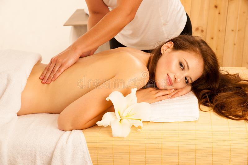 Body care. Spa body massage treatment. Woman having massage in t royalty free stock photography