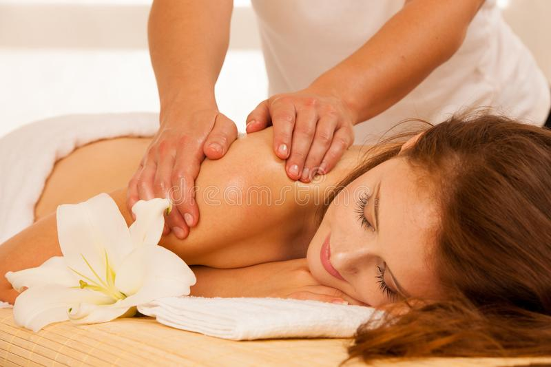 Body care. Spa body massage treatment. Woman having massage in t stock image