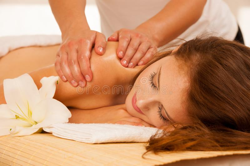 Body care. Spa body massage treatment. Woman having massage in t stock photo