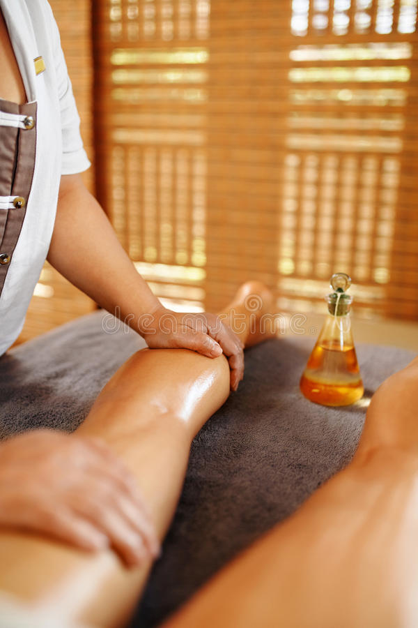 Body Care. Spa Massage Therapy. Woman Legs Anti-cellulite, Skincare Treatment. Body Care. Spa Massage Therapy. Closeup Masseur Massaging Long Female Legs With stock photos