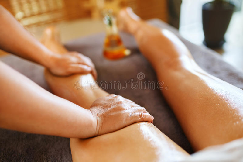 Body Care. Spa Massage Therapy. Woman Legs Anti-cellulite, Skincare. Body Care. Spa Massage Therapy. Closeup Masseur Massaging Long Female Legs With Essential royalty free stock images