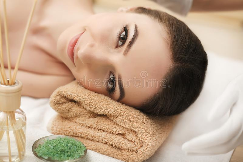 Body Care. Spa Woman. Beauty Treatment Concept. Beautiful Health. Y Caucasian Girl Relaxing On Massage Table Before Hand Massage On Relaxed Back In Health And royalty free stock photo