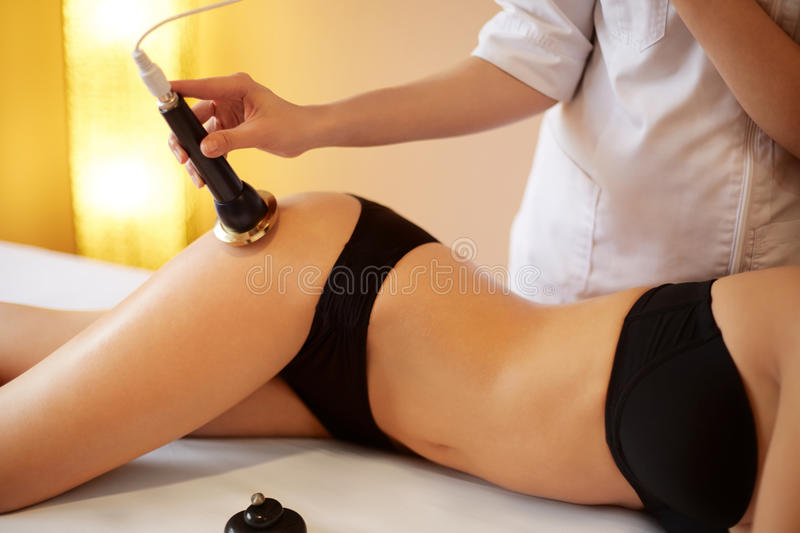 Body Care. Ultrasound Cavitation Body Contouring Treatment. Ant. I Cellulite stock photo
