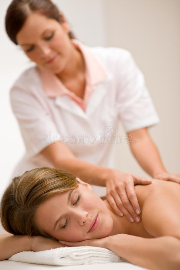 Body care - woman back massage royalty free stock image