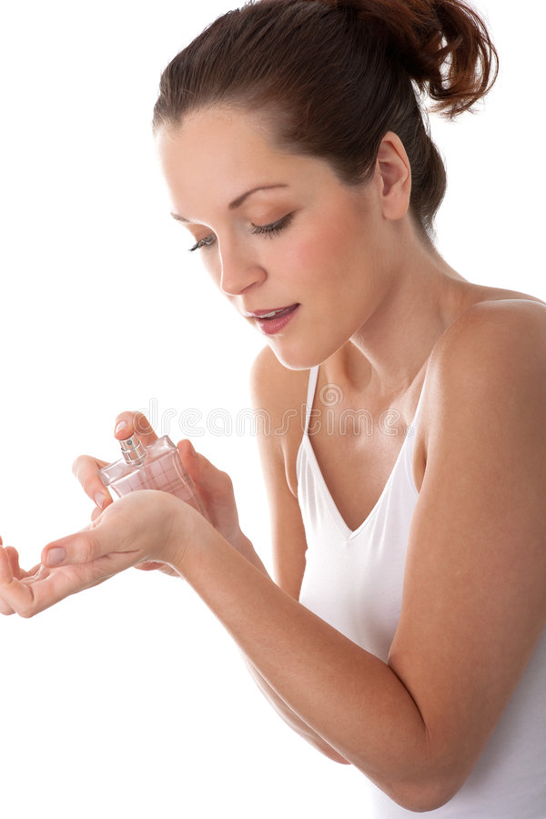 Body care - Young woman apply perfume royalty free stock photos