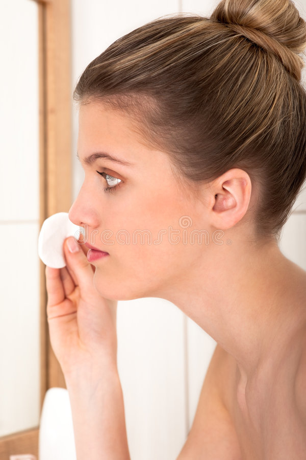 Body care - Young woman clean her face stock photo