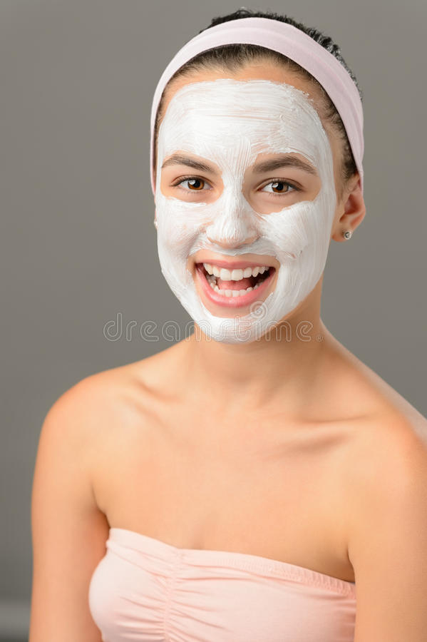 Body care young woman facial mask smiling royalty free stock photos