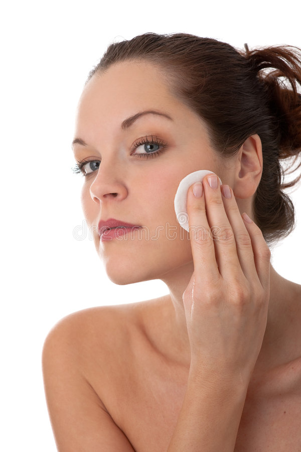 Body care - Young woman remove make-up royalty free stock images
