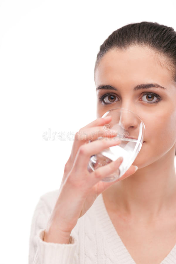 Body hydration. Young woman drinking a glass of fresh water, body hydration concept royalty free stock photo