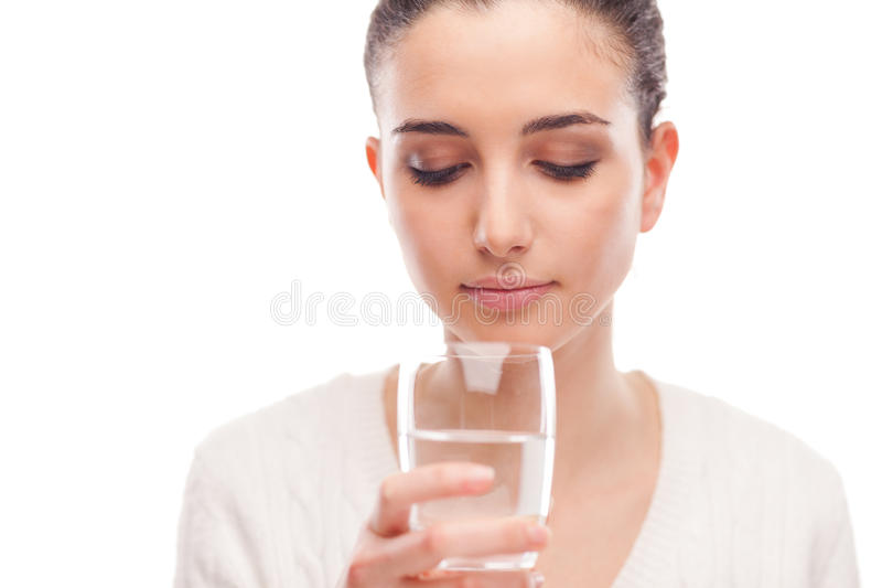 Body hydration. Young woman drinking a glass of fresh water, body hydration concept royalty free stock photography
