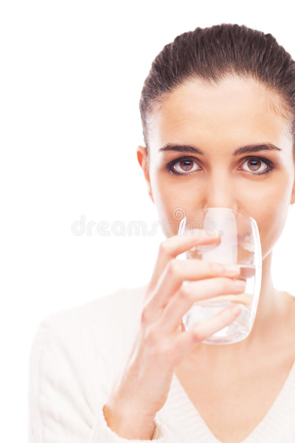 Body hydration. Young woman drinking a glass of fresh water, body hydration concept royalty free stock images