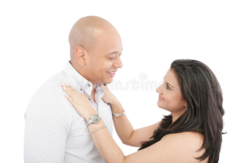 Body language and eye contact with love. Body language with eye contact and a touch of self expression with love and romance stock image