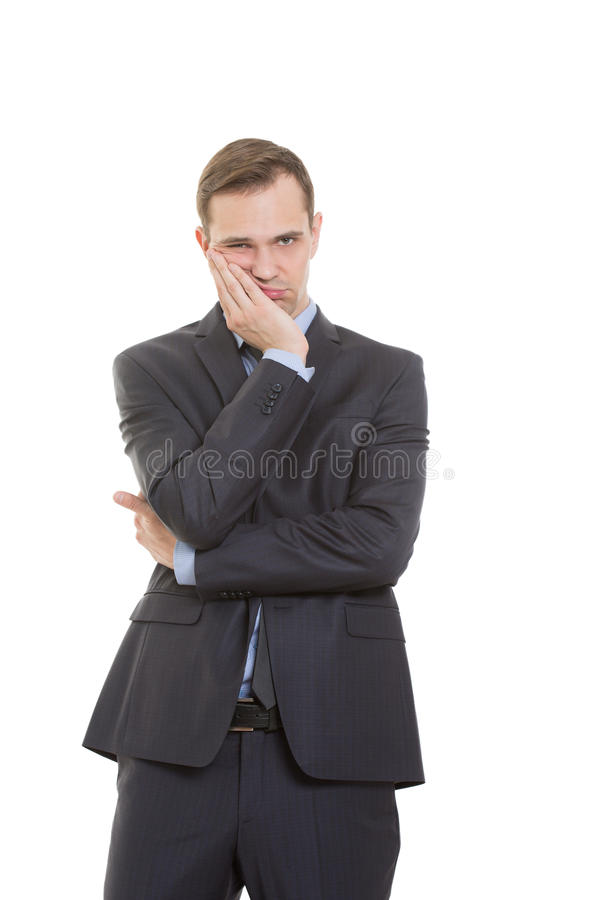 Body language. man in business suit isolated on. Body language. man in business suit isolated white background. Propping palm cheeks and chin. a gesture of royalty free stock images