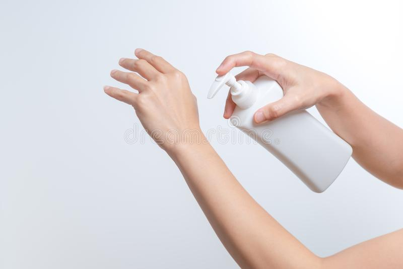 Body Lotion Skin Care Apply. women hands holding body cream pump bottle. Beauty And Body Care Concept stock images
