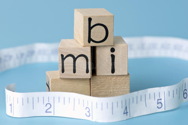 Body Mass Index. BMI body mass index letter blocks with tape measure stock image