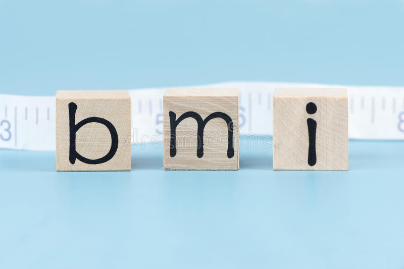 Body Mass Index. BMI body mass index letter blocks with tape measure stock photo