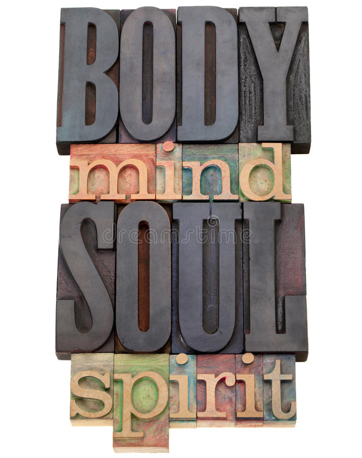 Body, mind, soul, spirit in letterpress type. Body, mind, soul, spirit - a collage of isolated words in vintage wood letterpress printing blocks royalty free stock photo