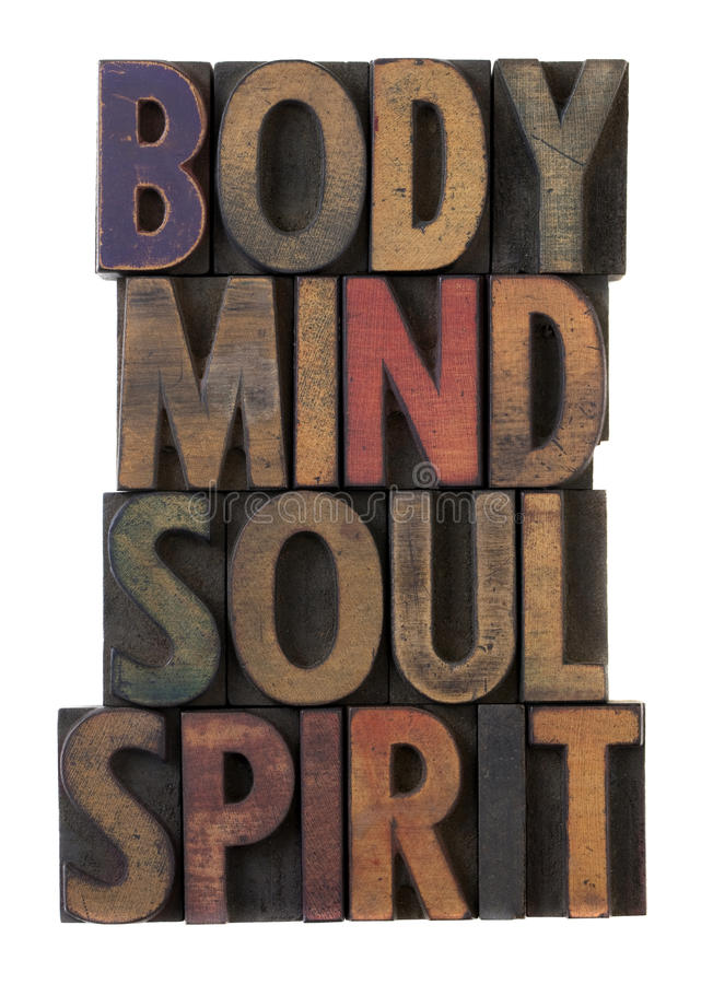 Body, mind, soul, spirit in old wood type stock photo