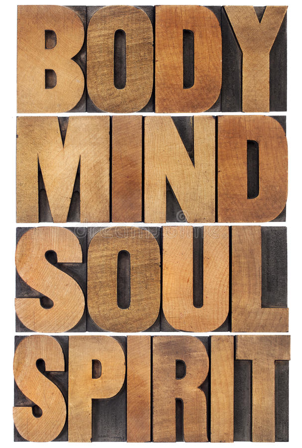 Body, mind, soul and spirit. Typography - a collage of isolated words in vintage wood letterpress type scaled to a rectangle royalty free stock images
