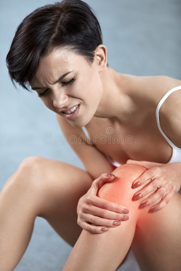 Body Pain. Beautiful Woman With Painful Knee, Feeling Leg Pain royalty free stock photo