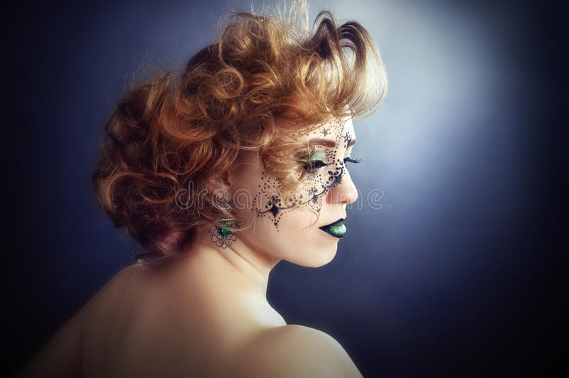 Body painting on face, beautiful girl royalty free stock photo