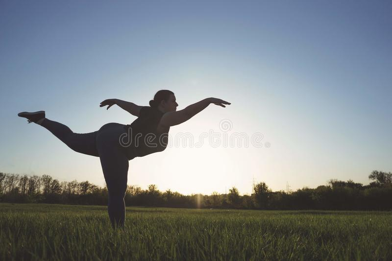 Body positive, confidence, high self esteem, free your mind conc. Ept. Overweight woman dancing outdoors, copy space royalty free stock image