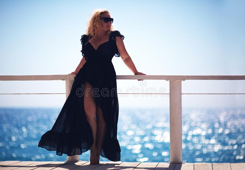 Body positive, plus size woman enjoys summer day royalty free stock images