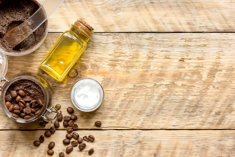Body scrub of ground coffee top view on wooden table.  stock photography