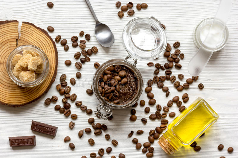 Body scrub of ground coffee top view on wooden table.  stock images