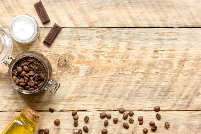 Body scrub of ground coffee top view on wooden table.  royalty free stock photography