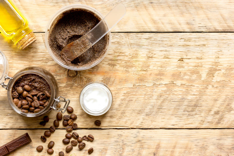 Body scrub of ground coffee top view on wooden table.  royalty free stock photos