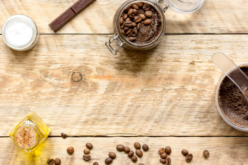 Body scrub of ground coffee top view on wooden table.  stock photo