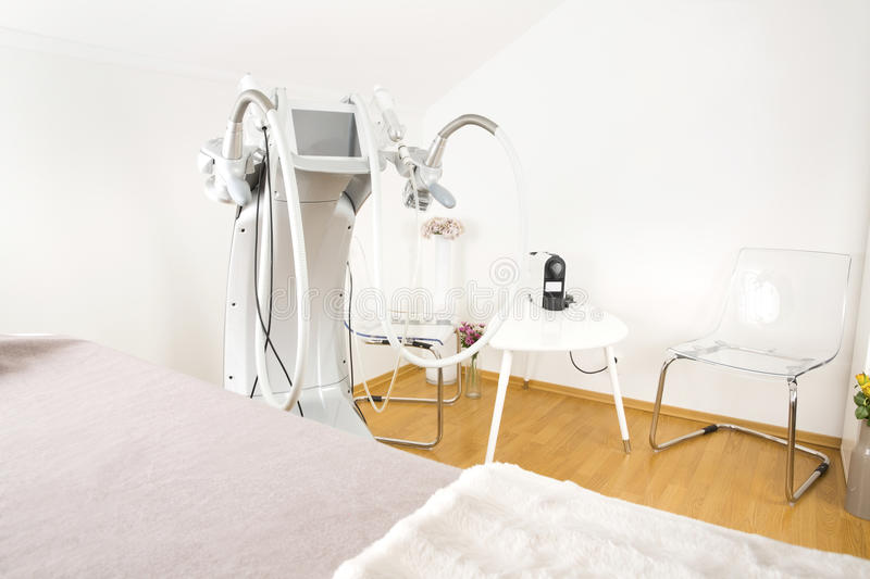 Body shaping clinic with advanced equipment. Client treatment room at a professional non-surgical full body shape and skin lift clinic. Advanced technology for royalty free stock images