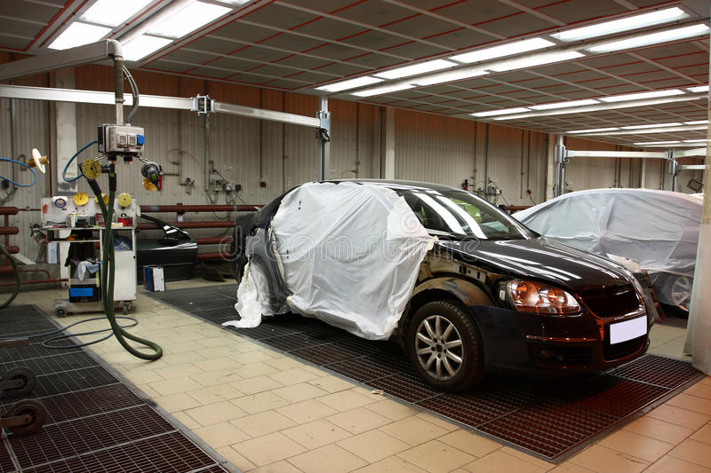 Body shop. The image of cars stand under repair in body shop