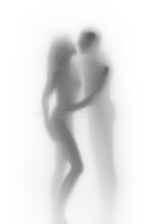 Body silhouette of lover couple, behind a diffuse surface. Female and male body shape can be seen behind a textile surface hidden royalty free stock image
